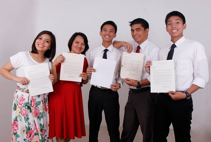 Family of five holding their mission calls.