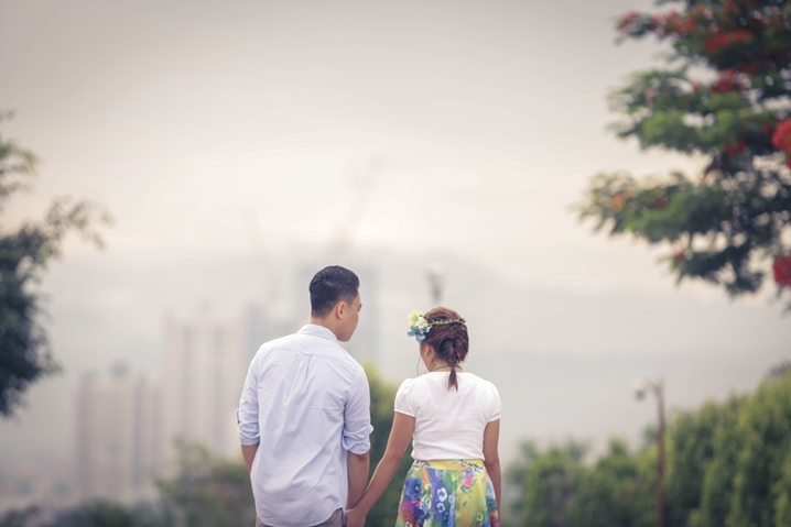 Newlyweds holding hands while walking
