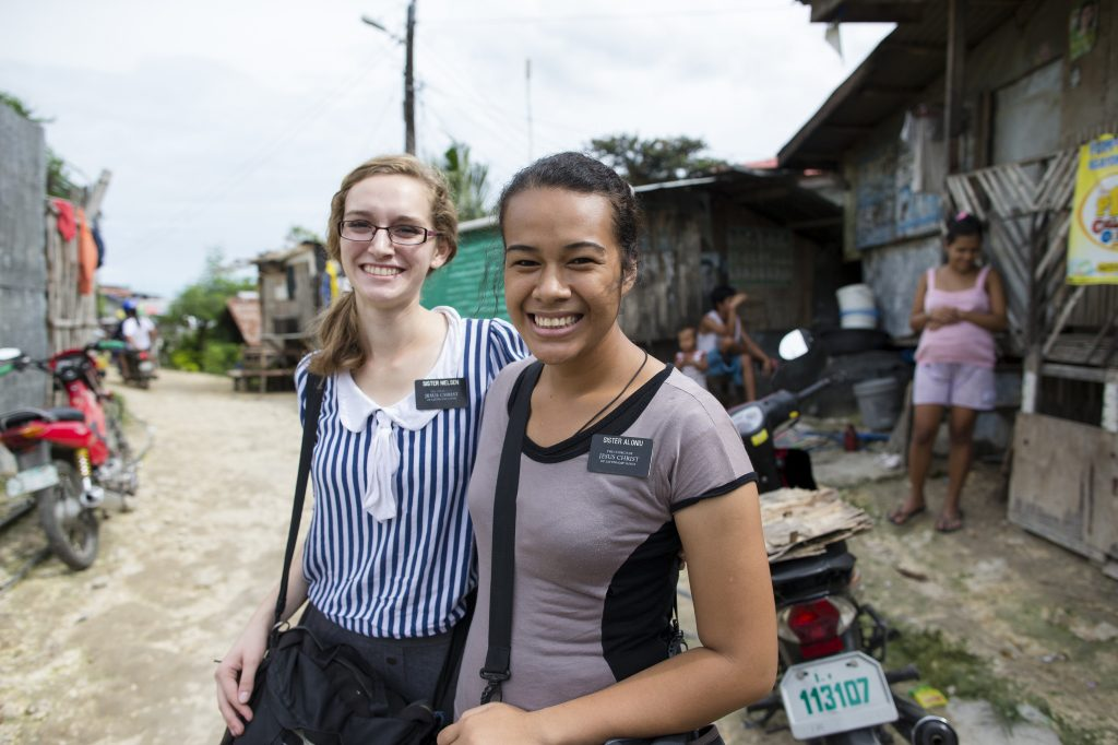 women Mormon missionaries in the streets
