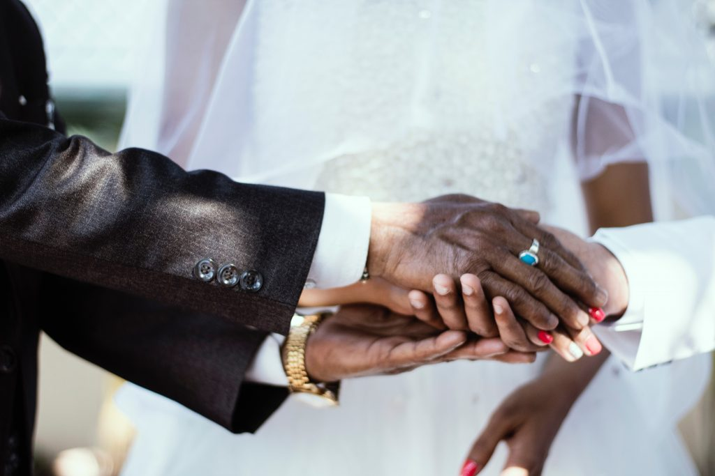 hands of father and daughter given to marriage