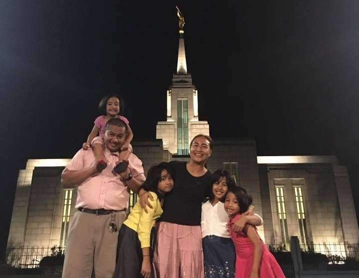 family standing outside Mormon temple