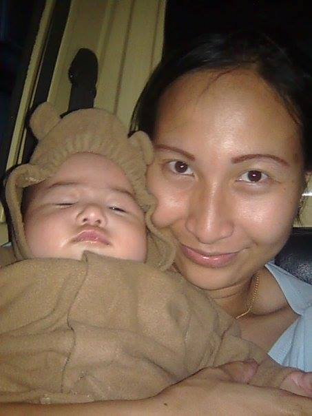 baby with bear jacket and mother