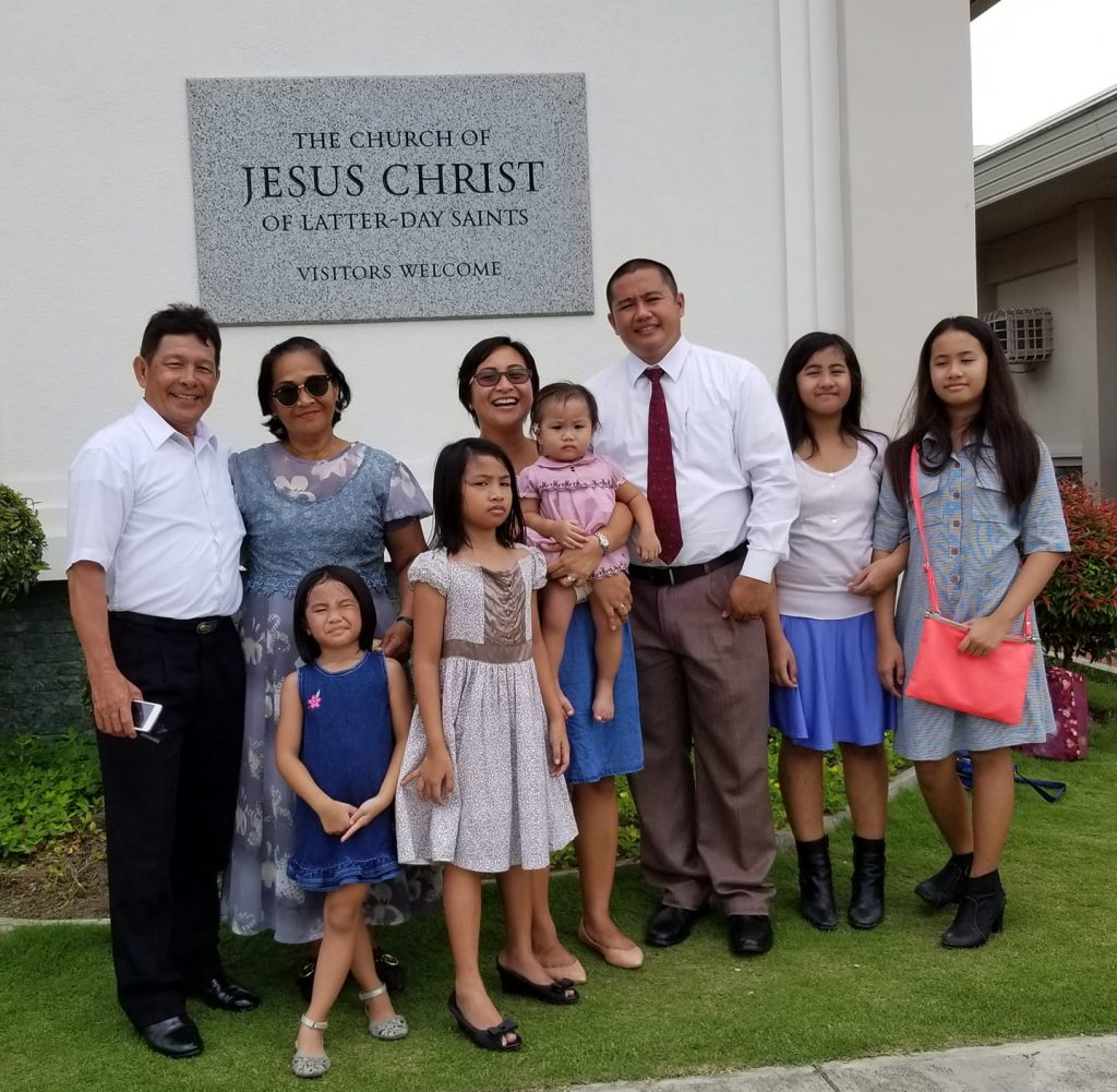 family in front of church